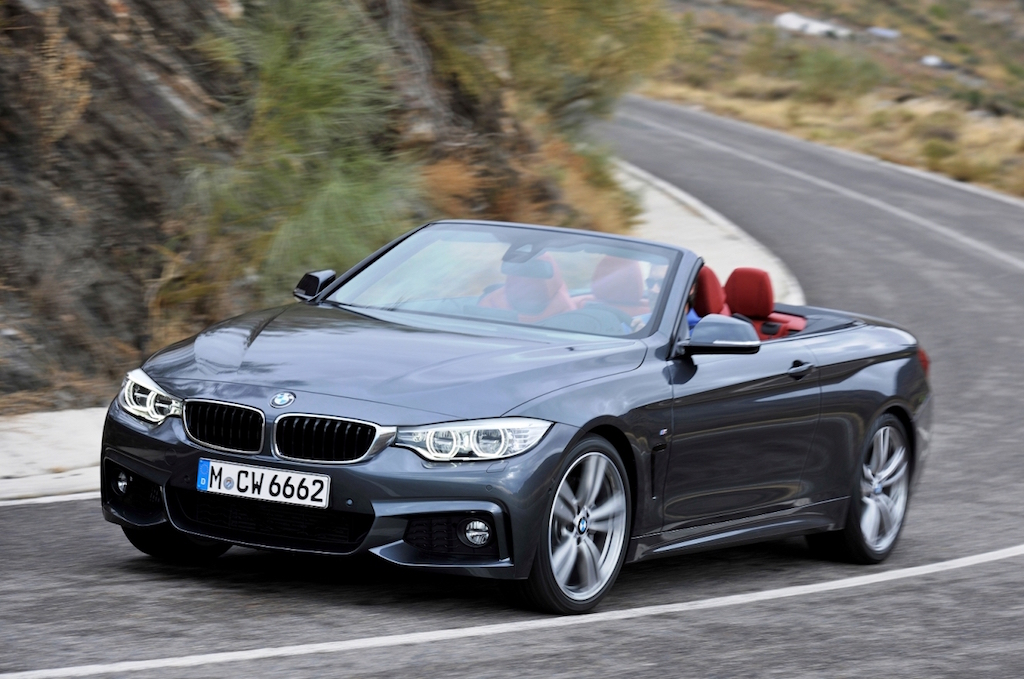 BMW 4 Series Convertible M Sport side front action copy
