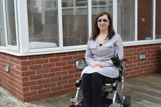 grey shirt dress, charity shopping tips, Wearing A Skirt As A Wheelchair User