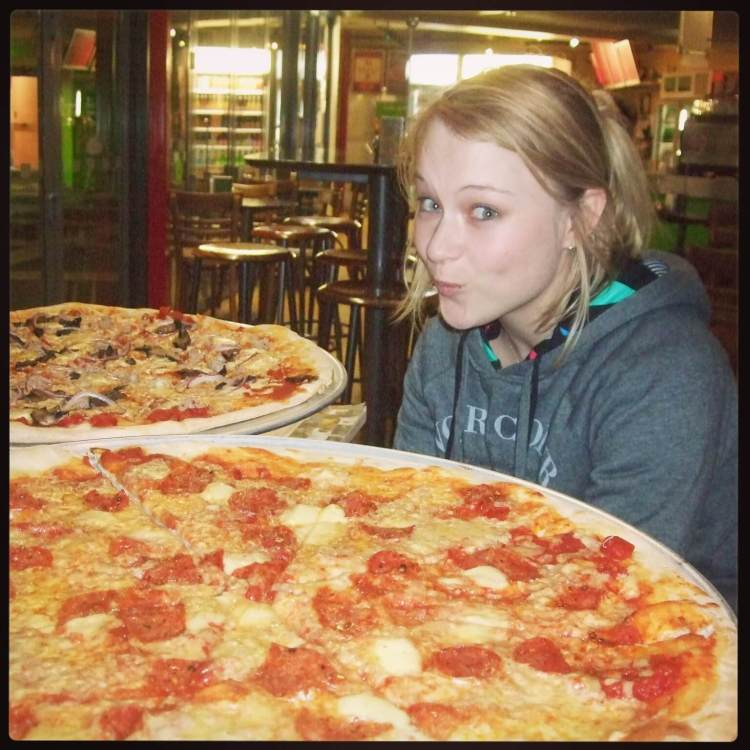 Wholly Pizza! The most amazing pizza ever. This is my beautiful friend Holly being dwarved by the size of this wonderful doughy delight.