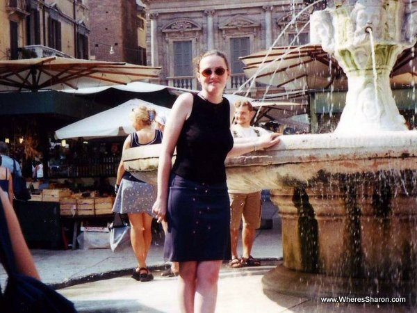 standing by fountain in verona