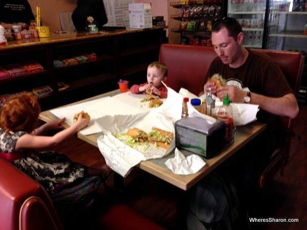 Family eating beef and chicken po-boys in new orleans