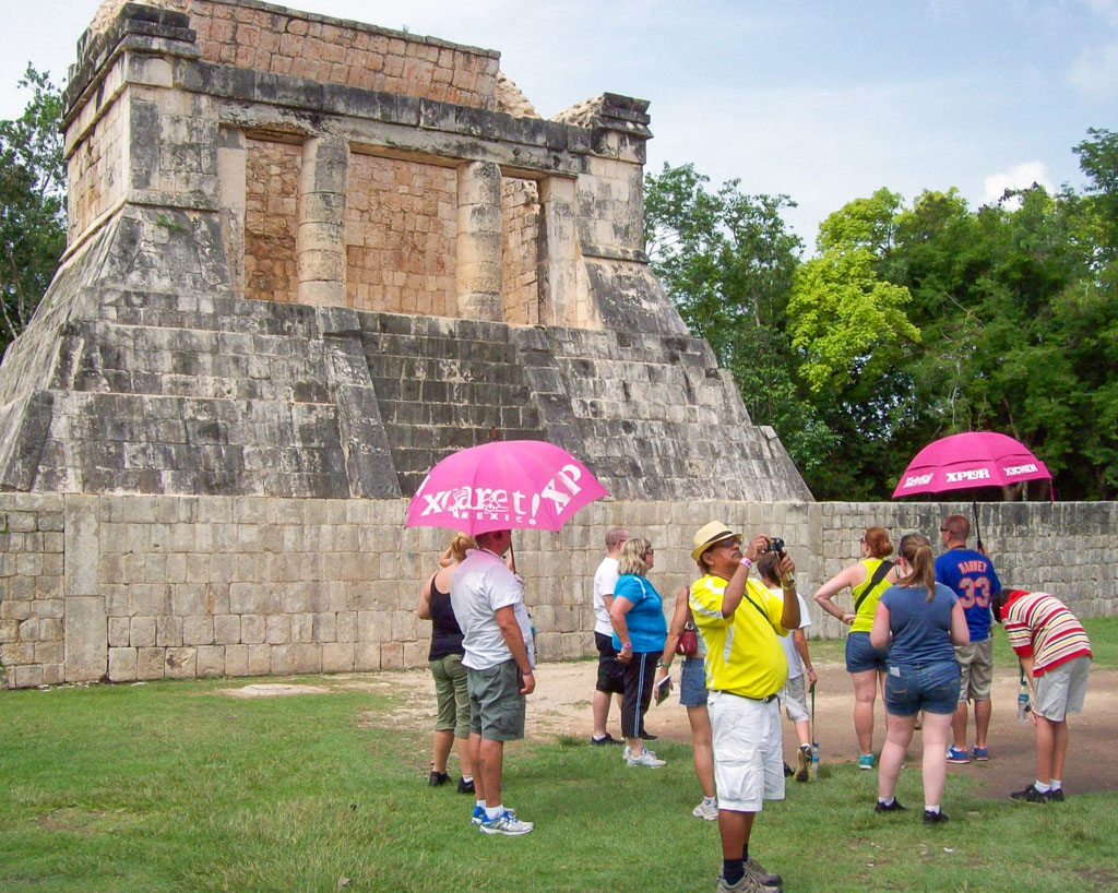 Tour Group Learning About the Incredible Acoustics at the Largest Ball Court in the Americas - Chichen Itza