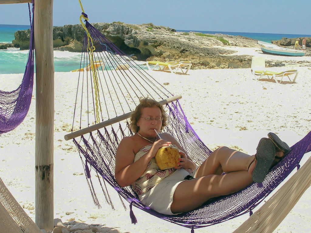 Relaxation Cozumel style, in a hammock on a sandy beach along the island's wild east side.