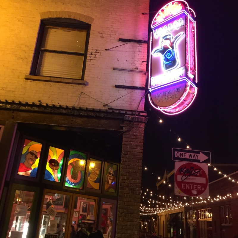 Love the neon sign for Voodoo Donuts.