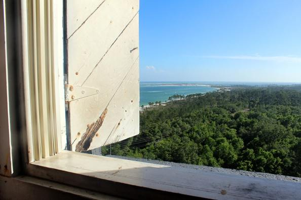 A view of the white sands and blue waters of Pensacola Beach from the lighthouse window