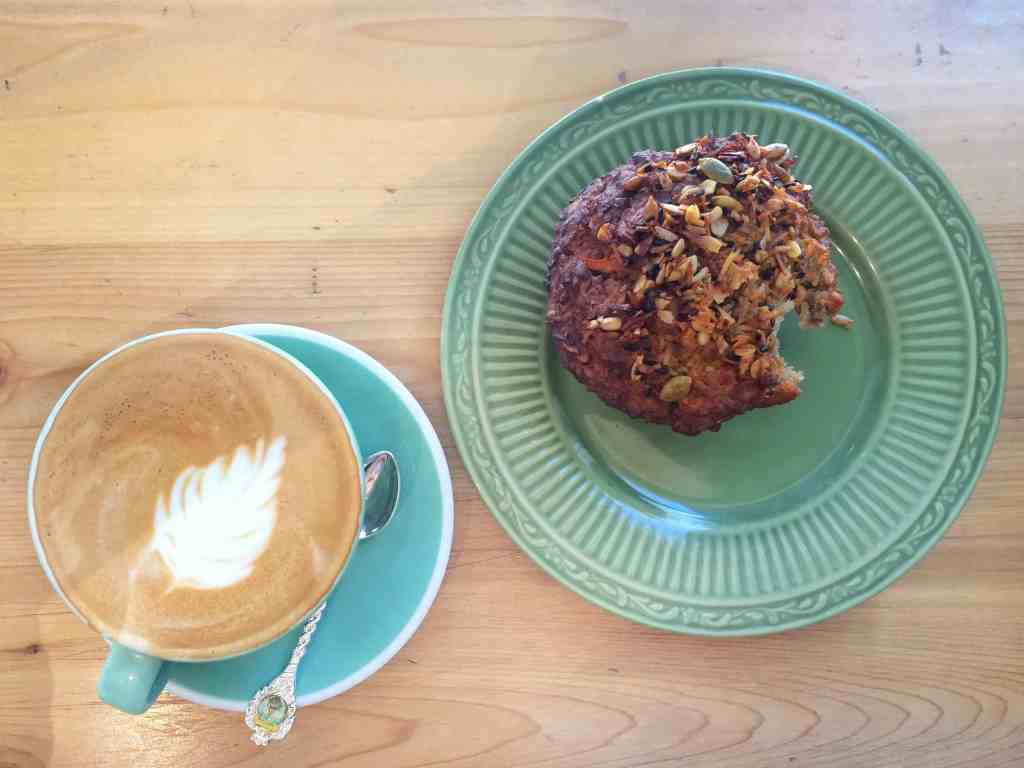 Almond latte and Innoncent Muffin at Fantail Bakery in Toronto