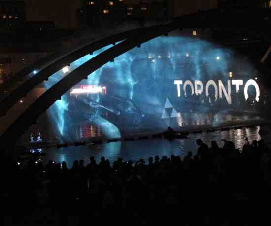 Nuit Blanche Toronto = Toronto sign lit up at night at City Hall
