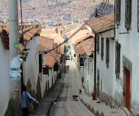 a street on a hill in cusco peru