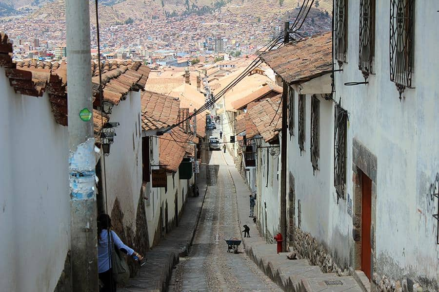 a street on a hill in cusco peru