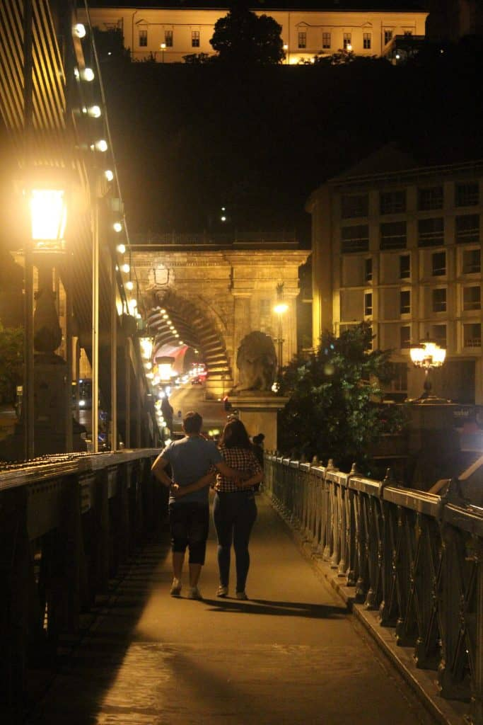 3 days in budapest - couple holding hands crossing the Chain Bridge