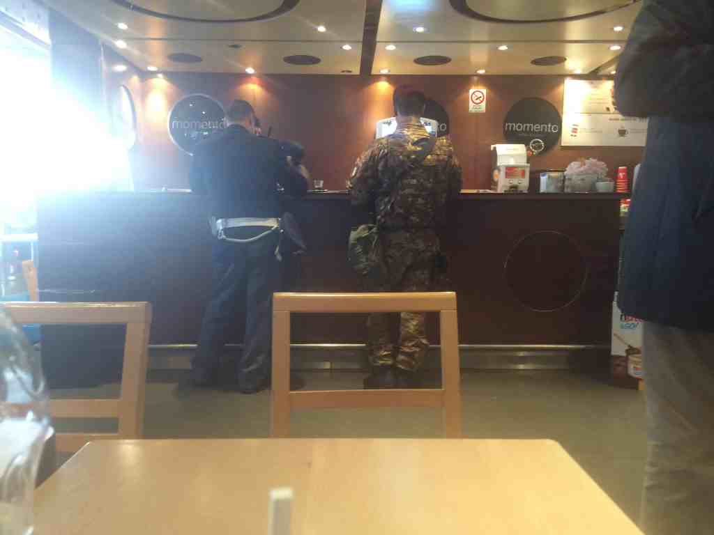 Leonardo Express Airport Train - Inside Momento cafe inside Roma Termini station. Police officer getting espresso shots