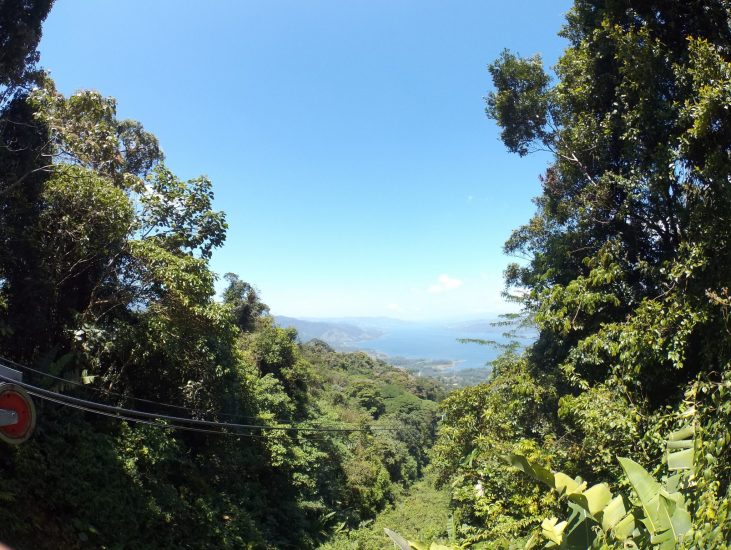 View looking down the mountain at Arenal Lake from a SkyAdventures  ziplining platform.
