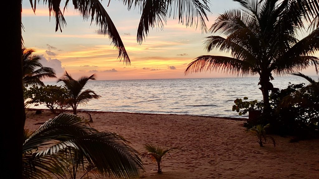 Sunset over the Caribbean Sea in Placencia, Belize.