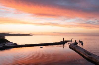 Whitby sunset returning boats
