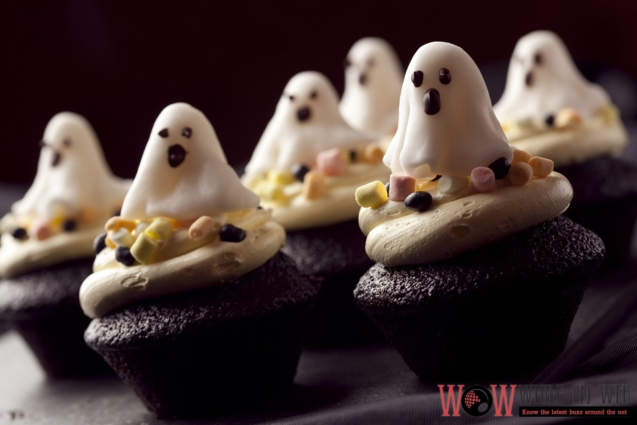 Ghost Cupcake Dark chocolate cupcake frosted with butter cream and topped with fluffy marshmallows shaped in a ghost