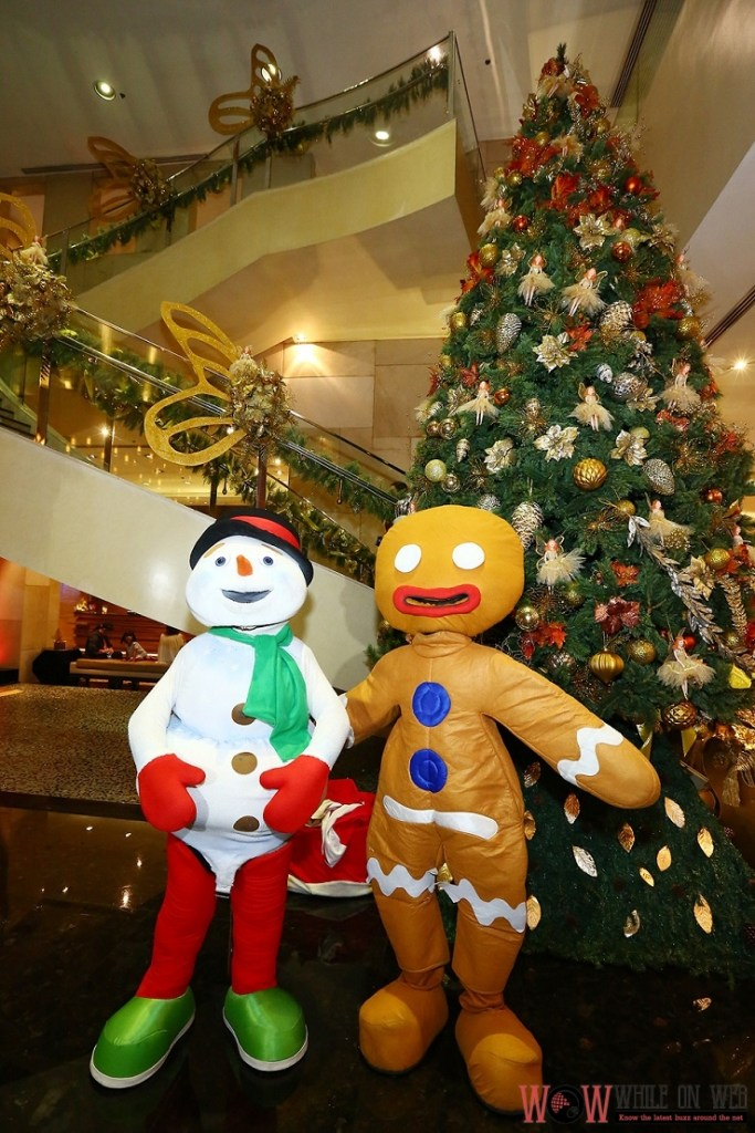 Welcoming guests at the tree lighting event are Snowman and Gingerbreadman