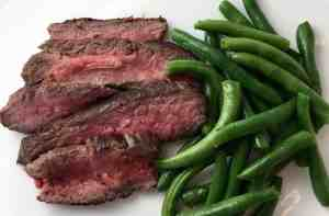 steak cooked medium rare served with green beans