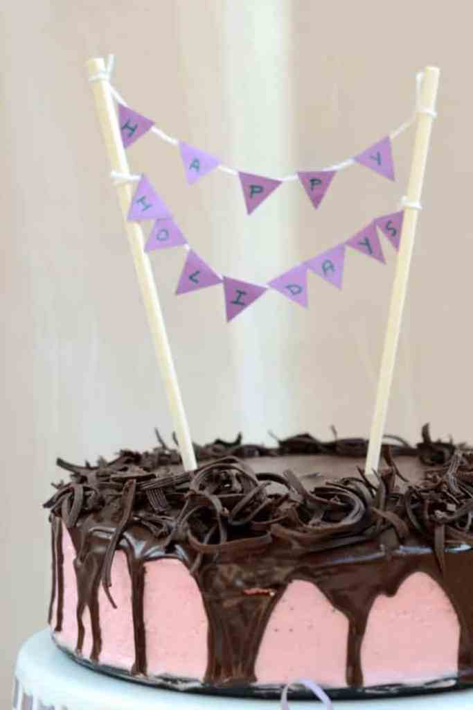 Dark Chocolate Cake with Blueberry Bavarian Cream and Chocolate Ganache is a delectably moist cake loaded with favor and freshness.