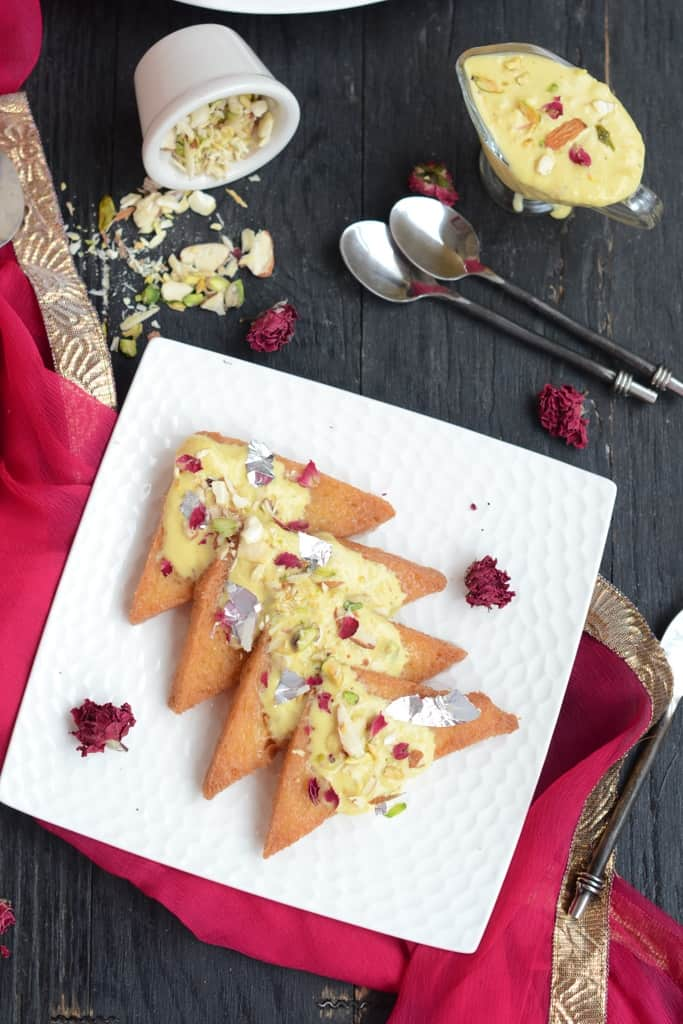 Shahi Tukda or Shahi Tukra is a traditional Hyderabadi Dessert made by deep frying bread slices in ghee and dunking it in sugar syrup.
