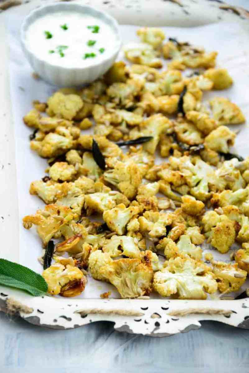 Honey roasted cauliflower with sage and sunflower seeds is a healthy and delicious option for snacks. Here is a tried and tested recipe to make it. Honey Roasted Cauliflower Recipe , honey garlic roasted cauliflower, honey garlic cauliflower delish, honey garlic cauliflower recipe, honey garlic cauliflower bites