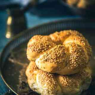 Turkish Bread Simit is a tender bread encrusted with sesame seeds which is served with salad, feta cheese, tea and can be eaten just as it is!