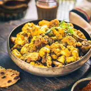Aloo Matar Gobhi is a simple, homely sabzi made using fresh peas, cauliflower, and potatoes. It can be served with Phulkas as well as Parathas.