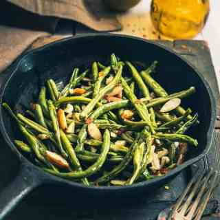 Sautéed Garlic Almond Green Beans is a timeless dish made from fresh green beans, butter, olive oil, almonds and a dash of garlic. Read its recipe.