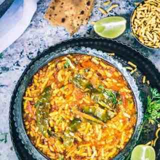 An incredibly humble accompaniment, Rajasthani Sev Tamatar Ki Sabzi is made using juicy tomatoes, desi masalas and served with heaps of besan sev.