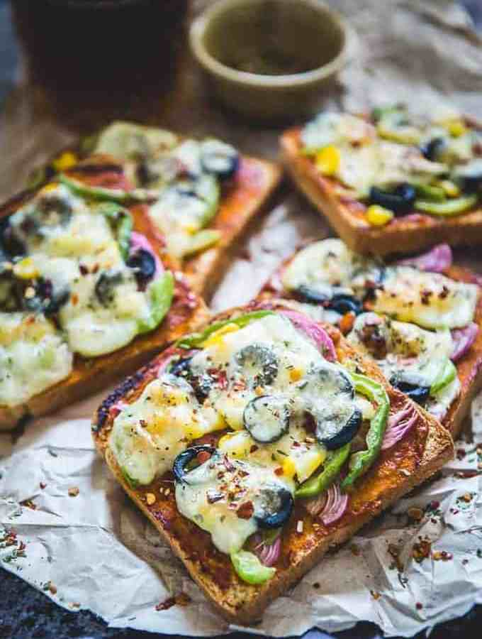 Vegetable Bread Pizza makes for a delicious breakfast or snacking option and can be made using basic ingredients which are mostly available at home.