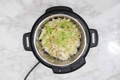 Bay leaf, cauliflower florets, and celery added in Instant Pot.