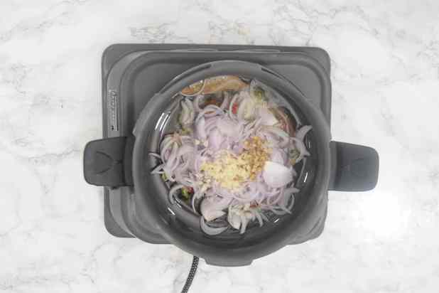 Onion, ginger and garlic added in the pan.