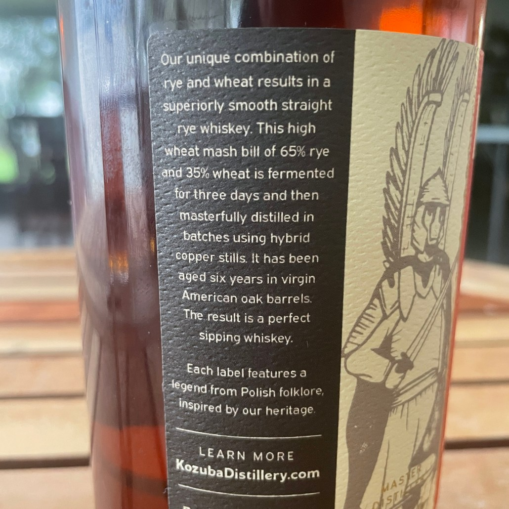 A picture of the back label of Kozuba & Sons High Wheat Rye Whiskey 7 Year Pick from Davidoff of Geneva in Tampa, FL