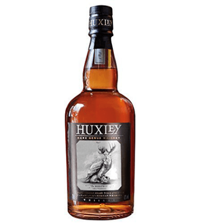 a picture of a bottle of Huxley Rare Genus Whiskey. Dark amber color with a black cap and logo with an image of an Mobsprey.