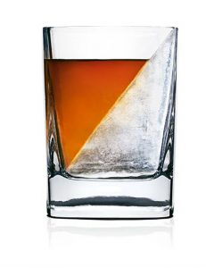 an image of the wedge whisky glass. A tradtional stumbler but designed to great a diagonla block of ise upon wheing the whisky is poured.