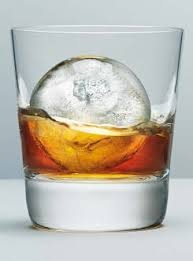 an image of an ice ball in a tumbler of whisky.