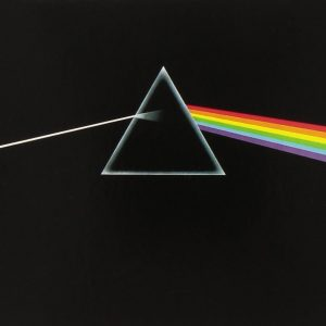 pink floyd's dark side of the moon album cover. a prism with a ray of light passing through it resulting in a rainbow of colors