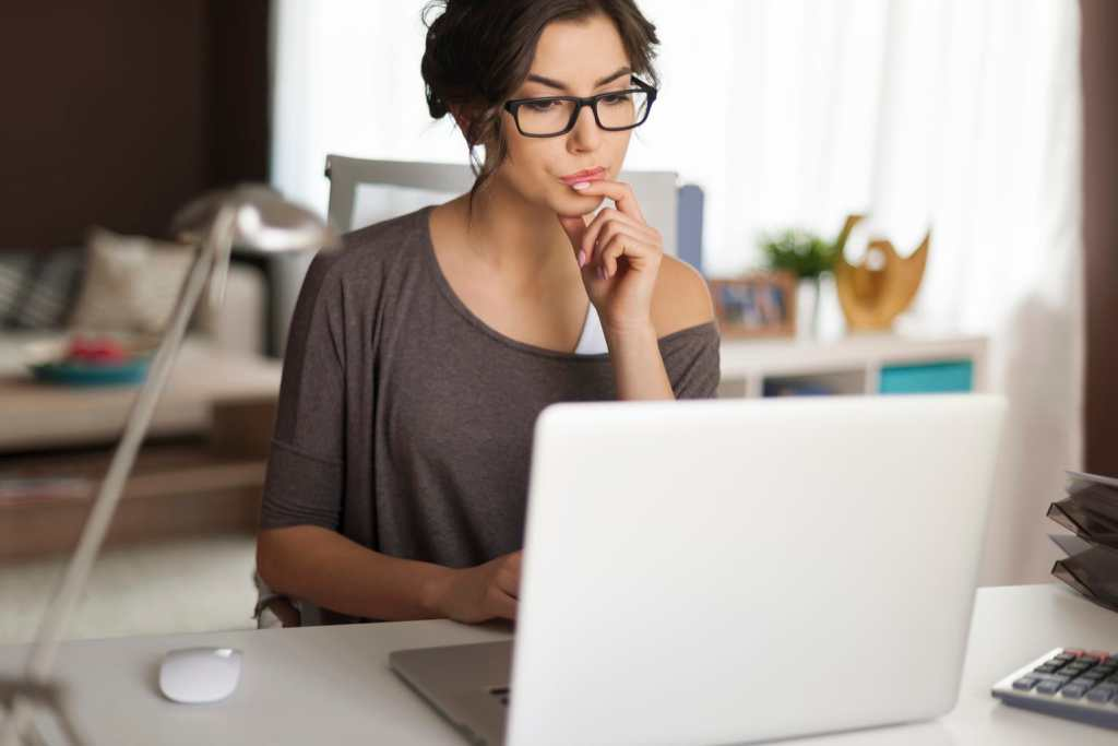woman working at home at laptop