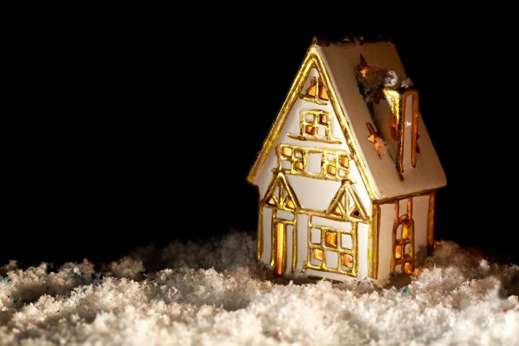Little toy house covered with artificial snow.