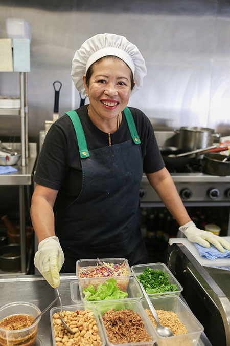 Asian woman chef in kitchen