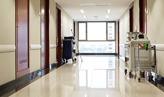 Interior of clean reflective empty hallway of hospital