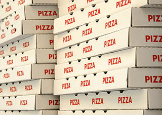 stack of piza boxes at a pizzeria