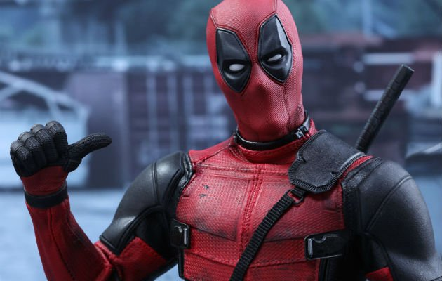 Deadpool points at himself with thumb