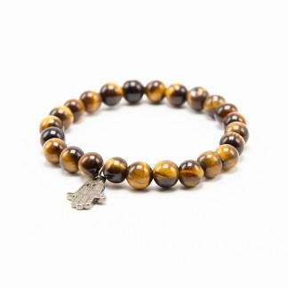 Magnifique Bracelet en Oeil de Tigre avec charms en acier. White Alpina vous propose la possibilité de lier d'autres charms en Argent 925.