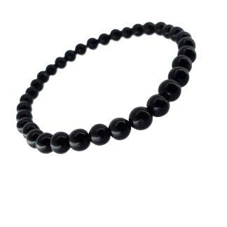 Magnifique Bracelet en Obsidienne . White Alpina vous propose ce bijou avec perles brillantes en 6 mm avec perles brillantes