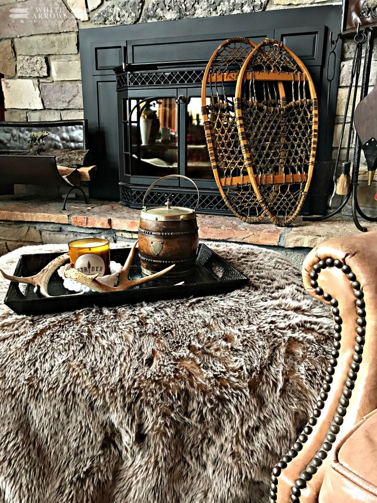 log cabin, cabin decor, rustic decor, winter neutral decor, cozy reading corner, vintage books, neutral decor, winter decor, cozy corner,leather chair, fur throw, snowshoes