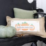 White brick ranch home- fall decor- decorating a small porch for fall- cottage home- outdoor decorating- home design- autumn decor- pumpkins- mums- front porch- handmade wreath- decorating with black and white- custom throw pillow- handmade pillow with seasonal panels