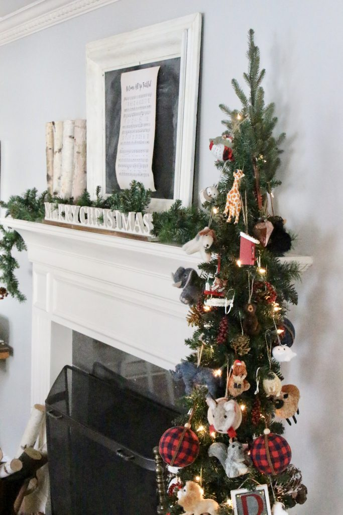 rustic- Christmas- mantel- mantle- animals- ornaments- slim tree in a basket- birch logs- copper pot