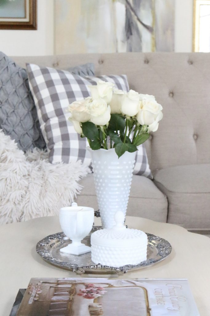 coffee table decor- scalloped edge- French country look- cottage style decor- coffee table styling- spring- pastel- milk glass- vintage items- handmade candle- White Cottage Home Store