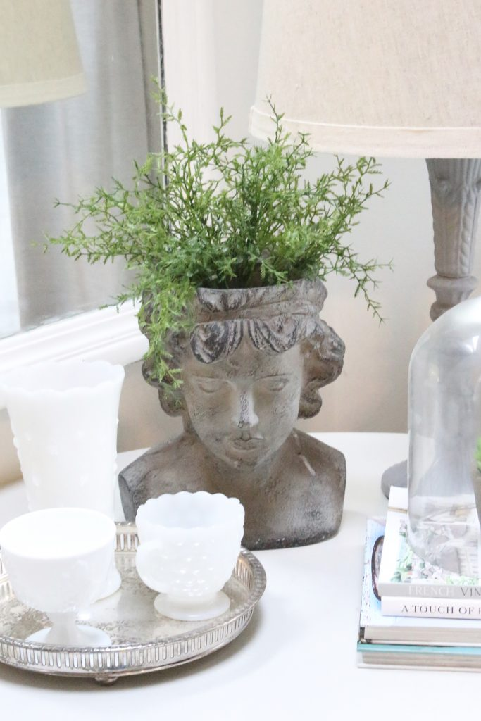 spring- decor- vignette- pedestal table- milk glass- faux greenery- decorating for spring- how to decorate a corner- white decor- silver tray- vintage decor