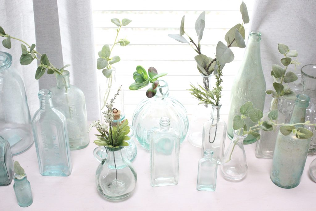 vintage bottles on display- vintage finds- green bottles- old bottles- jars- vases- displaying bottles- thrift store finds- antique bottles